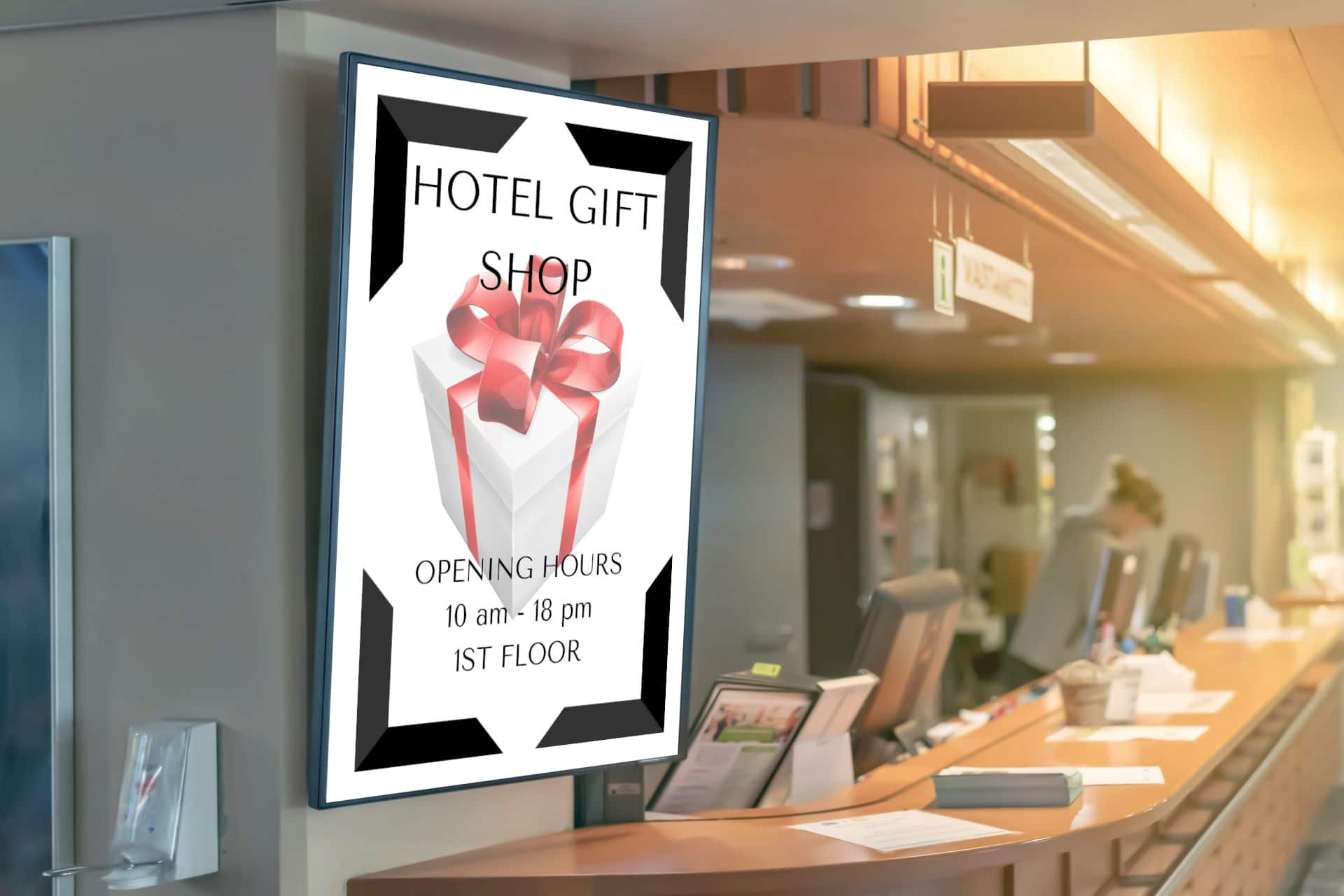 Digital signage display in front of hotel reception with information about hotel gift shop